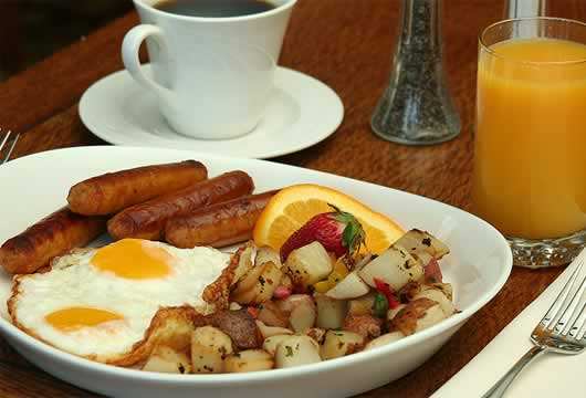 Delicious Breakfast of eggs, sausages, potatoes and coffee at Redwood Suites
